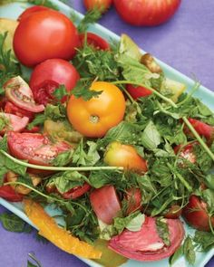 Heirloom Tomato and Herb Salad - This salad brings out the best in seasonal produce and fresh herbs. A simple drizzle of olive oil and white balsamic vinegar and some salt and pepper make the natural flavors shine.