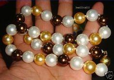 Murah Indah putih shell emas kalung mutiara 12mm Bebas Biaya Kirim, Kualitas Beli Lainnya langsung dari China Pemasok:  & nbsp ;   & nbsp ;   & nbsp ;   & nbsp ;   & nbsp ;    & nbsp ;    & nbsp ;                 Elegant Shell Kalung Mutia