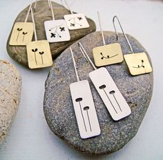 Modern & simple & unique. Original botanical designs, handcut in rectangular slices of sheet metal, mounted on long lightweight wires that swing