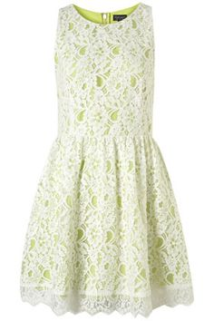 I LOVE this quirky little wink at the flouro trend! A sweet lace overlay ladies up a decidedly downtown shade