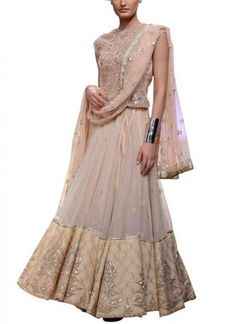 A cream lehenga set for any skin tone, Anita Dongre stuns yet again with her bridal wear on strandofsilk.com. Featuring a sheer lehenga enhanced with an embellished border, it has been complemented with a fully gota pati embroidered choli and a net embroidered dupatta. Complete your wedding day with this perfect ensemble, enriched with traditional Indian craftsmanship, for the modern bride #anitadongre #gotapati #embroidery #embellishment #lehenga #choli #dupatta #modernbride #wedding…