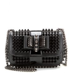 Christian Louboutin - Sweety Charity studded leather shoulder bag - It might be small in size, but Christian Louboutin's timeless black leather 'Sweety Charity' shoulder bag packs serious punch. Black spiked studs are a tough embellishment, softened by the bow-detail at the front. seen @ www.mytheresa.com