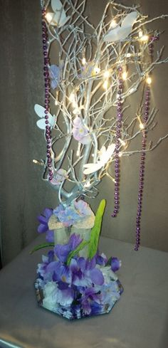 Butterfly Floral Centerpiece with LED Lights for Wedding or Events.  For info visit C&C Custom Creations on Facebook
