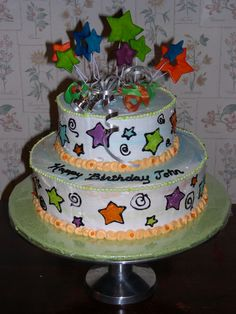 Cosmic Stars Birthday Cake - Two tier cake, buttercream icing marbled with different neon colors.  Fondant stars on top. Tinted piping gel for designs on sides of cake.