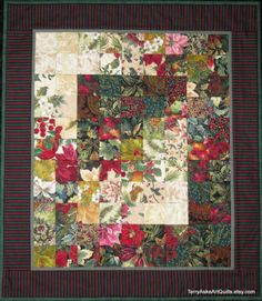 Get into the Holiday spirit with this medium sized Christmas hanging quilt well suited for seasonal decoration in any room or hall. This construction style is referred to as colorwash or watercolor and features small squares of fabric arranged with a gradual change from light to dark to form an overall design. The thin inner border is a sage green, the second border is a stripe in Christmas colors of red, green and black, and the binding is a darker green. A sleeve is sewn to the back so the…