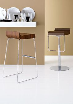 The Mood bar stool by Calligaris is stunningly simple. These kitchen stools are comprised of smooth lines that would make an elegant addition to your space. Available in two heights, plus an adjustable gas lift swivel version.  These bar stools have a chrome or satin finished frame and seat available in a variety of wood finishes.