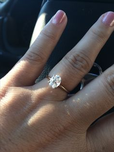 How perfect of a ring! Simple. Solitaire OVAL diamond with a super thin band! 1 carat on a size 7.5 finger just looks perfect.