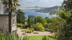 The view over the Salcombe estuary with the house and garden at Overbecks, Devon