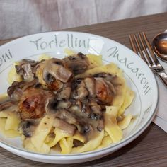 egg pasta with mushroom sauce and meatballs