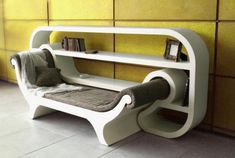 A cool reading corner. A lounger and a bookshelf. Saves space and looks comfy as well! :D