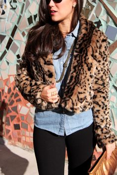 leopard print paired with chambray and black; I have a fake leopard fur jacket just like this one!