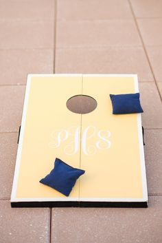 Monogrammed Yellow and Navy Corn Hole | Mikkel Paige Photography https://www.theknot.com/marketplace/mikkel-paige-photography-new-york-ny-428077