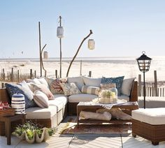 Comfy seating, love the beach in the background.  Not possible for my home, but nice to contemplate.