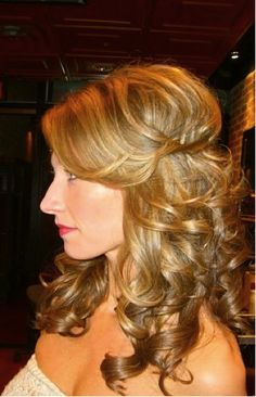 bouncy shiny curls. carrie underwood half up do from the side.