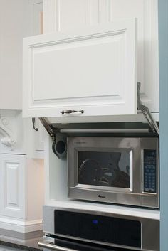 GREAT idea if the microwave isn't built in. I hate the way a microwave on the counter looks not to mention it wastes space! hide a microwave in a cupboard