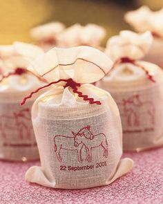 favors- jars of apple butter made at the farm where their wedding is held, packaged in muslin bags stamped with the date and tied with rickrack.