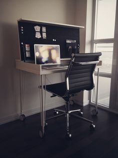 Love this desk from IKEA!  Fold this top down to mask your office space when not in use.