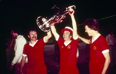 (From left to right): Tommy Smith, Ian Callaghan and Phil Neal parade the trophy