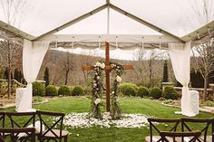 Love this gorgeous cross! #ceremony #altar #rusticchicweddings