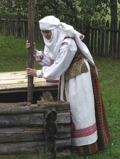 Europe | Portrait of a woman wearing traditional clothes, Lithuania Lithuania | Aukštaitė
