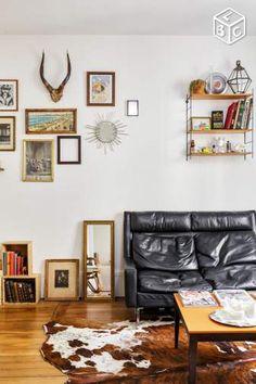 Canapé vintage cuir noir et déco vintage