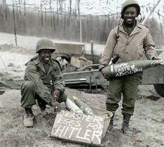 """Two American Soldiers proudly show off their personalized """"Easter eggs"""" (155mm artillery shells) before firing them. Colorized by retropotamus."""