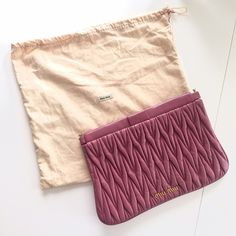 Miu Miu Clutch PINK MATELASSÉ LEATHER CLUTCH -- Gently used, excellent condition, beautiful dusty pink color Miu Miu Bags Clutches & Wristlets