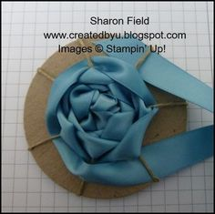 Ribbon rosette tutorial. Could even be made all fabric by using a yoyo instead of cardboard.