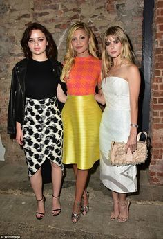 Lovely: Beside Oliva was Joey King and Carlson Young, who also flaunted their fashion prow...
