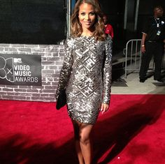 Denise Vasi struck a pose on the red carpet at the VMA's last night while wearing a Rubin Singer dress.  14 pounds of glass beading was more than enough to give Miss Vasi the amount of sparkle we're sure she sought.  A simple black clutch and heels completed her look as she kept jewels to the bare minimum.  Cute!