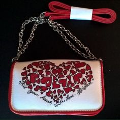 Brighton Heart Clutch. This clutch is perfect to hold a phone, cards and cash for a night out. It is small and easy to carry! NWOT Brighton Bags Clutches & Wristlets