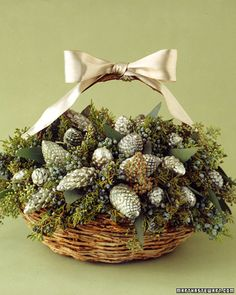 Pine cone lights basket with greens.