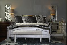 Grey walls and mirrored metallic furniture spiced up this master suite!