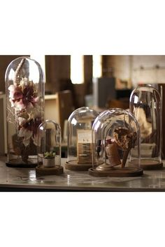 Glass dome. Perfect way to display special small items by themselves or grouped.