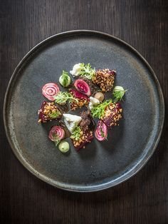 Roasted and shaved beets with peanuts, blue cheese, avocado, mustard greens, and…