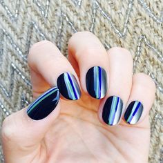 Capricorn  Step 1: Paint each of your nails with two coats of your dark blue polish.