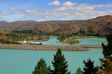 The Waitaki Valley in the South Island of New Zealand offers awesome views and many inexpensive campsites. http://travel-2-newzealand.com/places-to-visit-in-new-zealand-the-waitaki-valley/