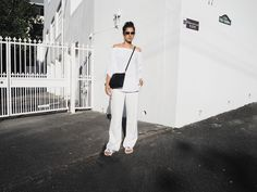 Elisa from www.schwarzersamt... is wearing an allwhite summer look with MANGO pants, SHEIN offshoulder blouse, CALVIN KLEIN slipper, IC!Berlin sunnies, &OTHER STORIES earrings. Location: Cape Town, South Africa
