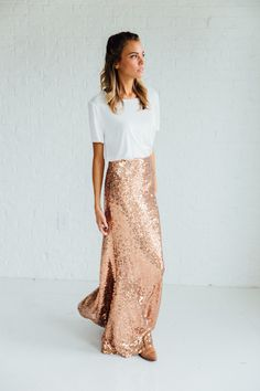 DETAILS: - Sequin Maxi Mermaid Skirt - Stretchy Lining - Perfect holiday party skirt - 100% Polyester - Model wearing a small