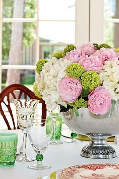 Go All Out with Fresh Flowers - Dress Up a Summer Table - Southernliving. Showcase the bounty of the season with a lush arrangement of pink peonies, white hydrangeas, and green…