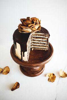 French Opera Cake with six layers of espresso soaked sponge alternating with layers of dark chocolate ganache and coffee french buttercream.