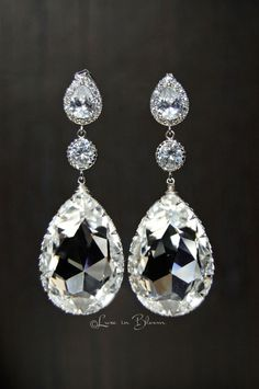Wedding Chandelier Earrings Elegant and sophisticated clear Swarovski crystal chandelier earrings are a glamorous accessory.  * Crystal clear large Swarovski crystal drops * Cubic zirconia ear posts * Nickel Free * Rhodium plated settings * Rhodium plated cubic zirconia teardrop connectors...