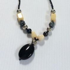 Lovely honey jade and black agate!.  Matching bracelet also available.