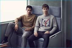 Sitting on a train, Hao Yun Xiang and Sebastien Andrieu embrace smart casual holiday style with H&M.