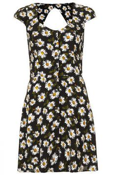 I had a dress similar to this when I was a little girl that I adored! Daisy Open Back Tea Dress (Topshop)