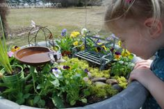 Magical Fairy Garden made with miniatures! So fun to make with your kids. They will want to check back every day and see if the fairies were there.