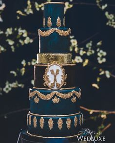 This #weddingcake gets an #opulent treatment with gold foil and midnight blue tiers- truly regal! | Photography By: Blush Wedding Photography | WedLuxe Magazine | #wedding #luxury #weddinginspiration #luxurywedding #cake #dessert