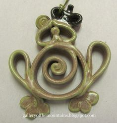 Coil clay pottery frog ornament