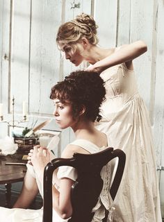 Keira Knightley and Rosamund Pike as Elizabeth and Jane Bennet, in their underpinnings, from Pride and Prejudice (2005).