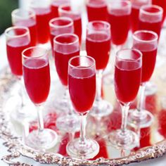 Sparkling Cranberry Blush  3 cups cold water  2 (48-ounce) bottles cranberry juice cocktail, chilled $  2 (6-ounce) cans thawed lemonade concentrate, undiluted  2 (750-milliliter) bottles brut champagne, chilled (Delamotte Brut NV)